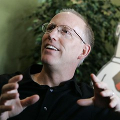 Scott Adams gazing off and smiling