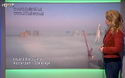 Rotterdam in de wolken