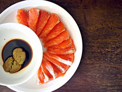 Salmon sashimi with a non-kosher bowl of wasabi paste + Sashimi soya sauce
