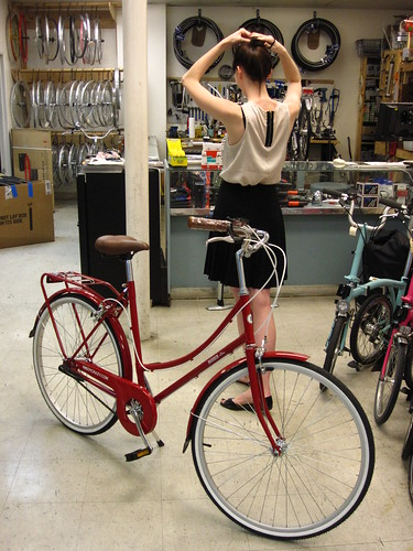 The long and slender Alexi Wasser next to her Bobbin Birdie at Flying Pigeon LA bike shop