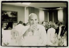 Man with glass of white wine - Fotos de invitados de bodas Edward Olive wedding guests photos