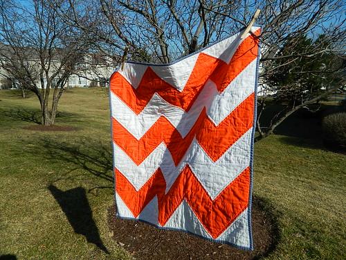 tangerine orange and white zig zag quilt
