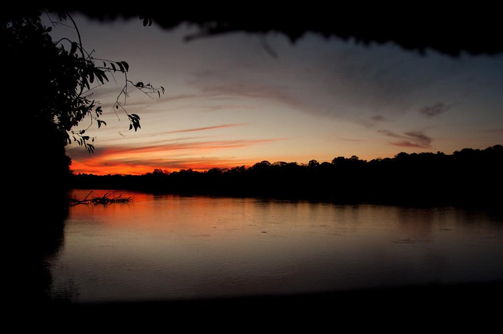 Jason.Kopp.03.SunsetThroughHut.Tambopata,Peru.jpg