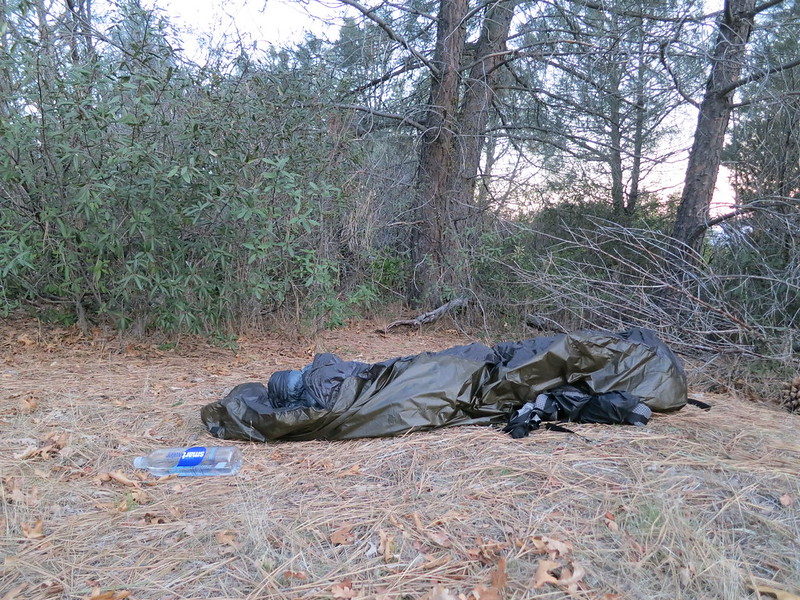 A pile of trash bags, or my campsite in the morning? Bivy sack, sleeping bag, pack under feet.
