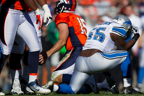 "Stephen Tulloch ""Tebowing"" after sacking Denver quarterback Tim Tebow"