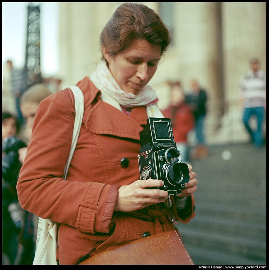 A lady holding a Rolleiflex camera