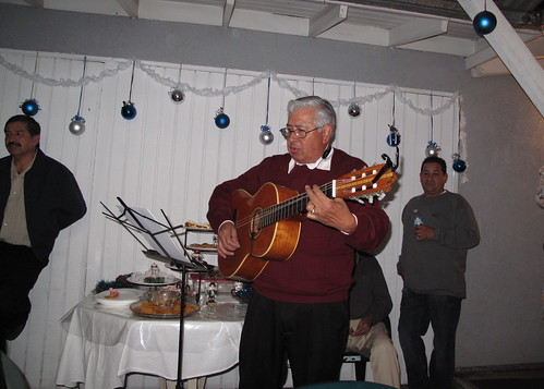 Dad leads the Christmas caroling