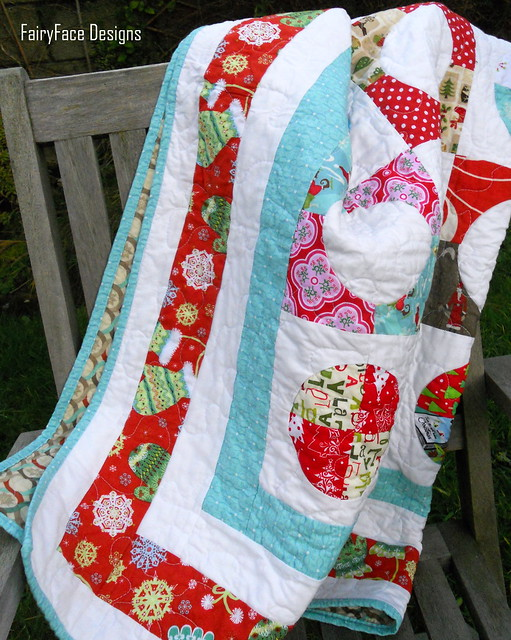 Christmas quilt draped on chair