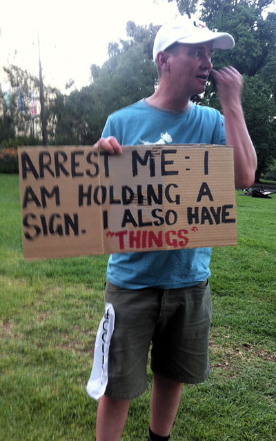 Kev + sign + things: arrest this man