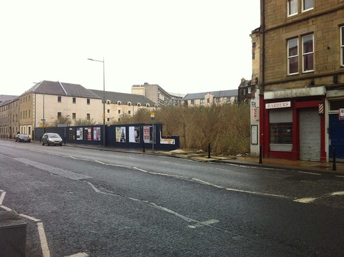 Hoardings around this Great Junction Street gap site blew over