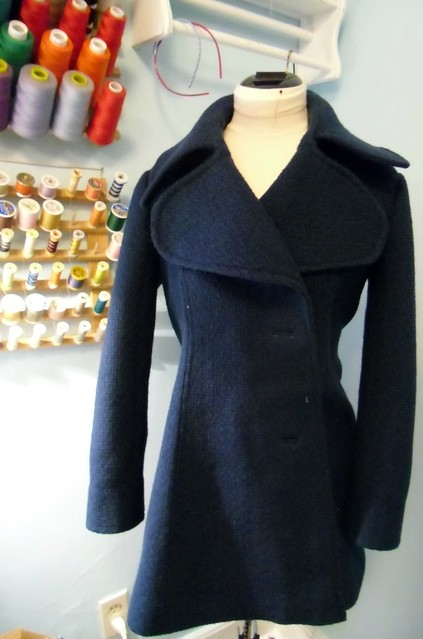 coat with topstitching
