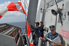 SOUTH CHINA SEA (Feb. 3, 2012) Quarter Master 3rd Class Amanda Shykes (right) aboard USS Chafee (DDG 90) runs a flag hoisting exercise with the Republic of Korea Navy ship ROKS Munmu the Great (DDH 976). Quarter Master Seaman Elora Presseau (center) and Quarter Master Seaman Neisha Kirkling (left) assist with the flag hoist by raising and lowering the flags, along with helping decode Munmu the Great's signals. (U.S. Navy photo)