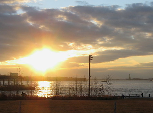 Bright Sun In the Dusk Sky, Near The Statue Of Liberty