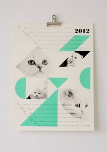 A one page calendar that shows four spliced images of a fluffy white cat, accompanied by various turquoise shapes across the page.