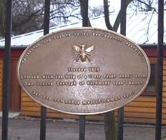 Aged brass sign