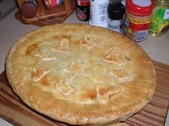 flatbread(0.0), pizza(0.0), zwiebelkuchen(0.0), pie(1.0), pot pie(1.0), baked goods(1.0), food(1.0), focaccia(1.0), dish(1.0), dessert(1.0), cuisine(1.0), quiche(1.0),