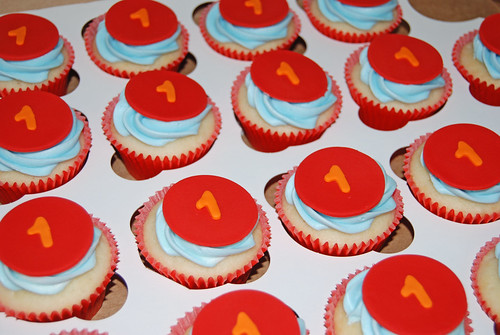 1st birthday cupcakes blue red and orange