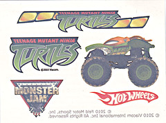 """ Hot Wheels "" Monster Jam ' Teenage Mutant Ninja Turtles ' 1:64 Monster Truck - Michelangelo {  MUD TRUCKS tire treads } 53/80 ..AUTHENTIC MONSTER JAM TATTOO ii  (( 2011 ))"