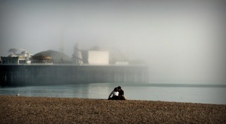 Lovers watching the fog over Brighton's Pier