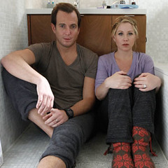 Chris and Reagan from Up All Night, sitting on the floor of their bathroom