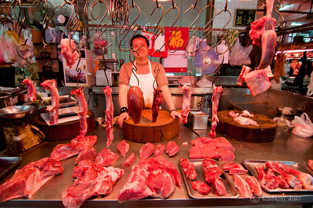 A butcher at Red Market MAcau