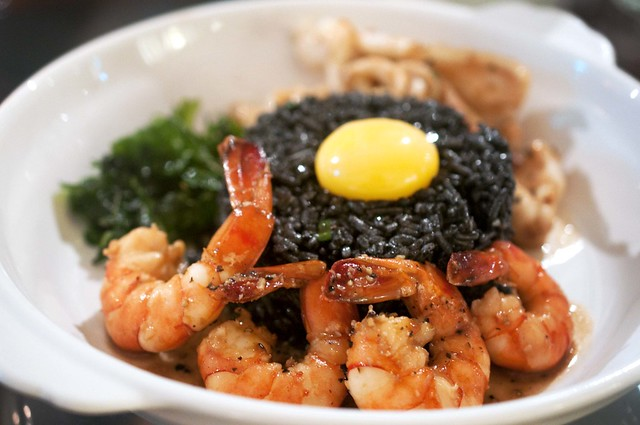 Squid Ink Rice with Prawns & Squid + Eggyolk - $19