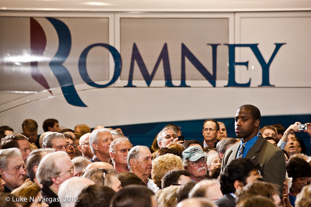 Romney's Bodyguard Towers Over the Crowd