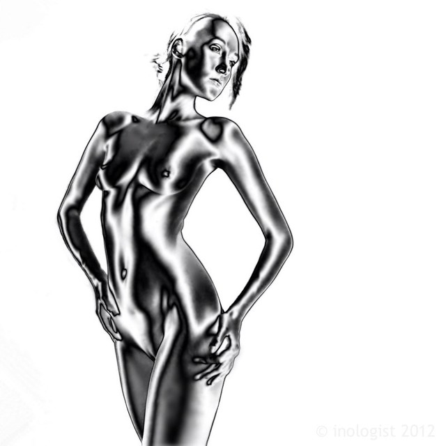 image of a naked woman on white background. Processed in Man Ray style solarisation