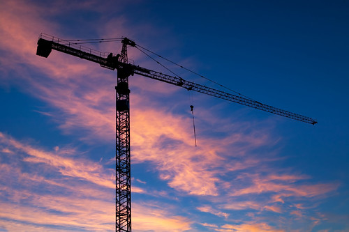 sunset sky building industry architecture sunrise dawn construction industrial commerce crane machine growth commercial derrick build silhouetted nightfall