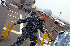 MANILA, Philippines (Jan. 29, 2012) Logistics Specialist 3rd Class Corley Miller prepares to throw a heaving line as the guided missile destroyer USS Wayne E. Meyer (DDG 108) moors in Manila. (U.S. Navy photo by Mass Communication Specialist 1st Class Grant P. Ammon)