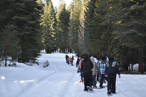 Snowshoeing enthusiasts enjoy a guided trek on the Lassen National Forest in California. (Photo credit:  Esther Miranda-Cole, Public Affairs Specialist, Lassen National Forest)