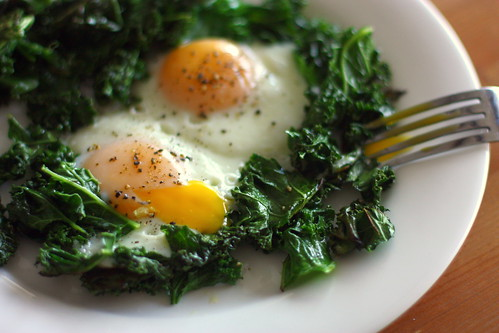 fried eggs and crispy kale