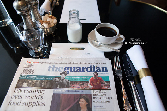 Cup of filtered coffee and reading The Guardian