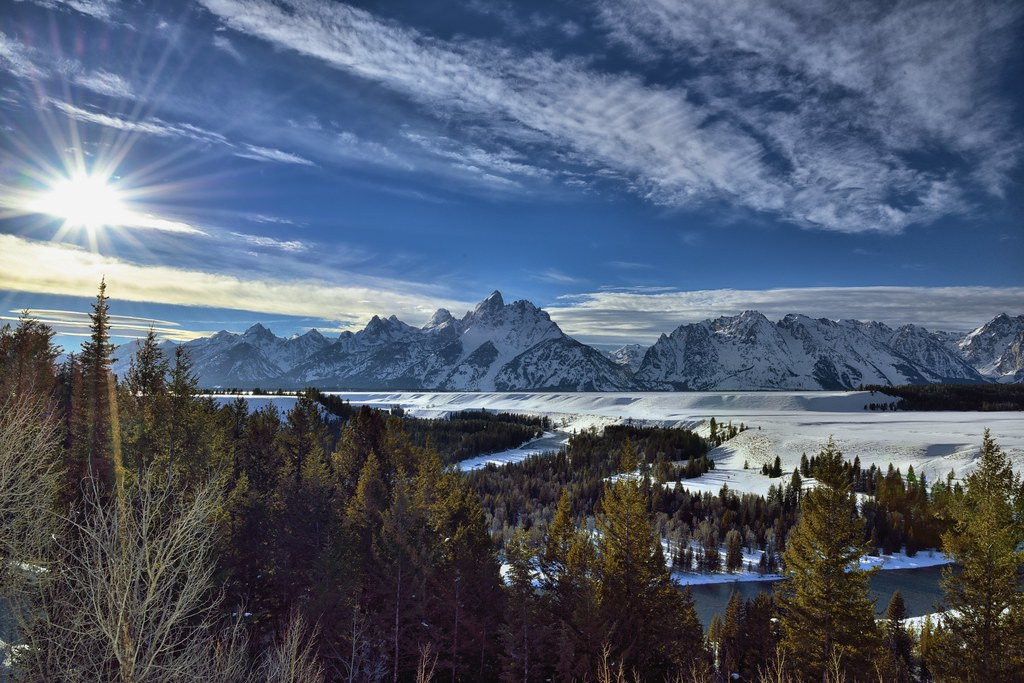 The Sun Shines Over the Snake River and Teton Mountains Peaks