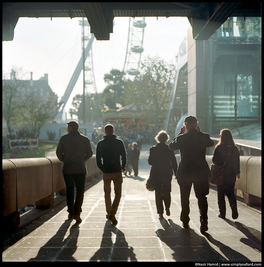 People walking towards the London Eye