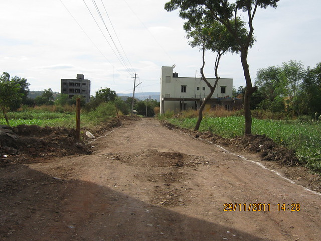 Under construction 21 feet wide road to Urbangram Kirkatwadi - A 2 BHK Flat for Rs. 25 Lakhs on Sinhagad Road, Pune 411 024