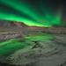 Green Stream - Aurora near Reykjavík Iceland by orvaratli
