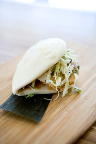 fried chicken and slaw bao on white bun by TAKE A BAO