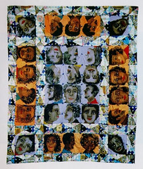 a quilt that is stitched with faces in the squares