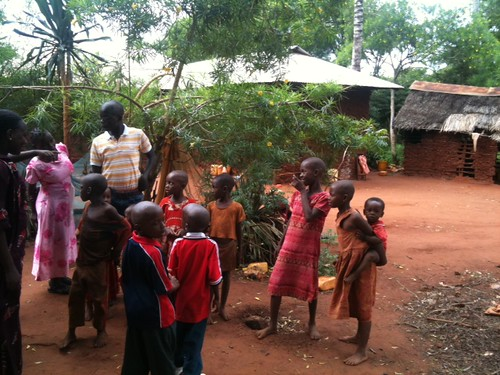 Village children so excited to see the family return