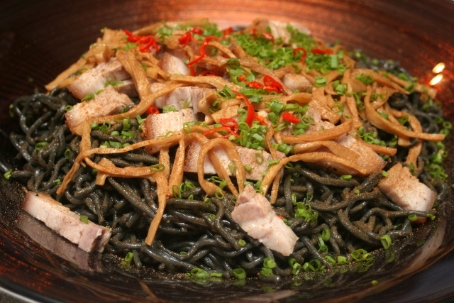 Umami Ramen (Bamboo Charcoal Noodle) served with roast pork