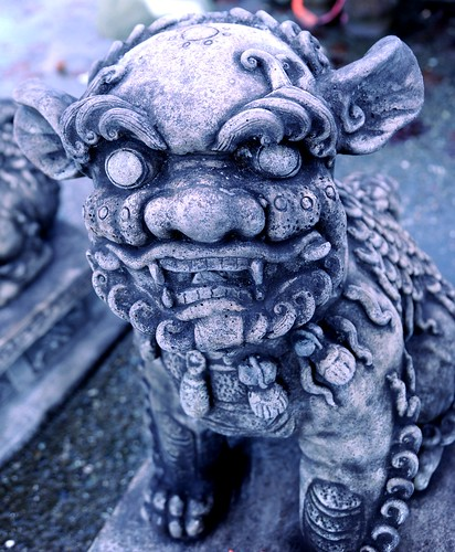 Snow Lion / Foo Dog, protector with big nose and a toothy grin, fur covered eyes, concrete statue, Lake City Way, Seattle, Washington, USA by Wonderlane