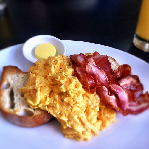 Scrambled eggs on toast with bacon at Speakeasy