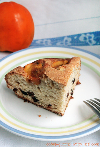 Cake with dried persimmons and beads on yoghurt