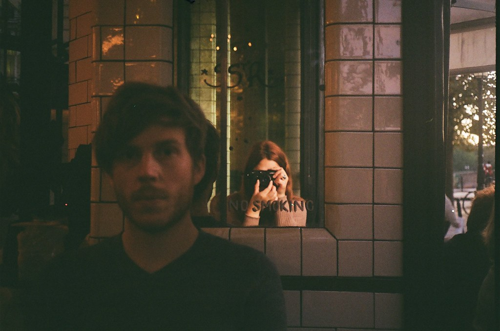 LE LOVE BLOG LOVE STORY PHOTO IMAGE COUPLE AT RESTAURANT TAKING A PHOTO MIRROR REFLECTION LOVE DOESN'T CHANGE WE DO Untitled by Mafalda Silva, on Flickr