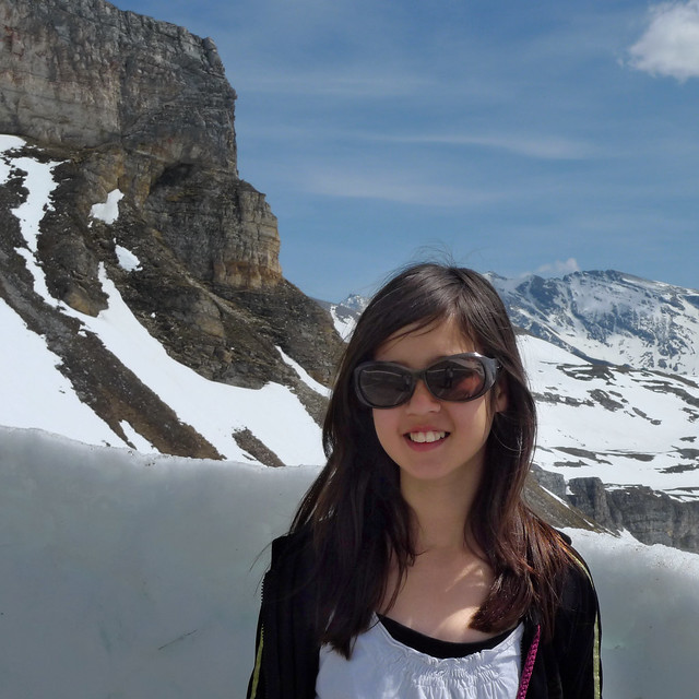 Samantha standing on the snowy edge of the High Alpine road