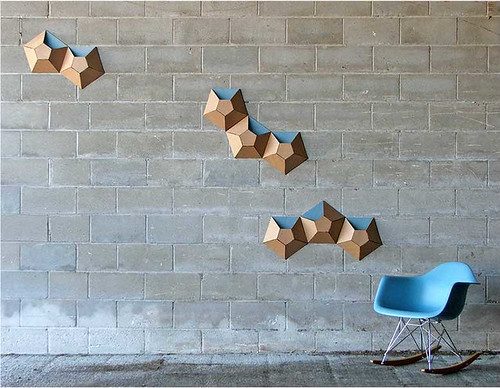 cardboard sculpture wallpockets on cinder block wall