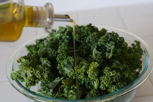 Add olive oil to the kale