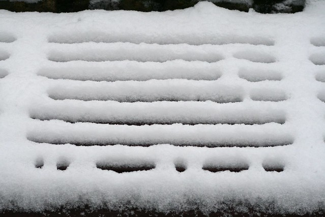 A bench covered in snow