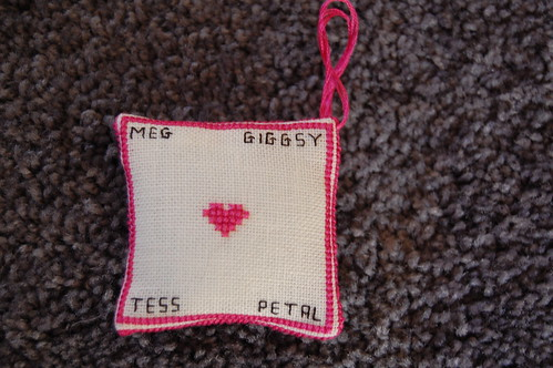 I stitched my cats names on the back